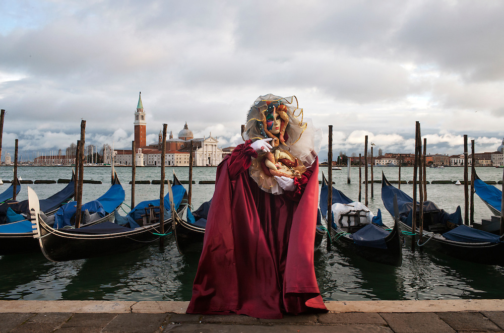 A Carnival Mask poses in San Marco in Venice during the carnival.