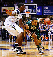 INDIANAPOLIS, IN - FEBRUARY 13: Roosevelt Jones #21 of the Butler Bulldogs guards as Pierria Henry #15 of the Charlotte 49ers dribbles to the hoop at Hinkle Fieldhouse on February 13, 2013 in Indianapolis, Indiana. Charlotte defeated Butler 71-67. (Photo by Michael Hickey/Getty Images) *** Local Caption *** Roosevelt Jones; Pierria Henry