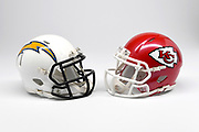 Detailed view of Los Angeles Chargers and Kansas City Chiefs helmets.