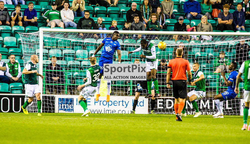 Pictured: Efe Ambrose clears the danger<br /> <br /> Hibs welcomed Molde to Easter Road for their second home game of the Europa League campaign