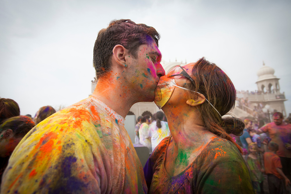 Although love is in the air at the Holi Festival of Colors, on Saturday, Mar. 24, 2012, at the Lotus Temple, in Spanish Fork, Utah, colored powder is also in the air. Many in attendance wear eye, nose and mouth protection to avoid in taking unwanted powder. (Photo by Benjamin B. Morris ©2012)
