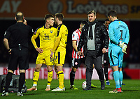 Football - 2018 / 2019 FA Cup - Third Round: Brentford vs. Oxford United<br /> <br /> Oxford United head coach Karl Robinson comes on to the pitch as Shandon Baptiste is treated for an injury, at Griffin Park.<br /> <br /> COLORSPORT/ASHLEY WESTERN