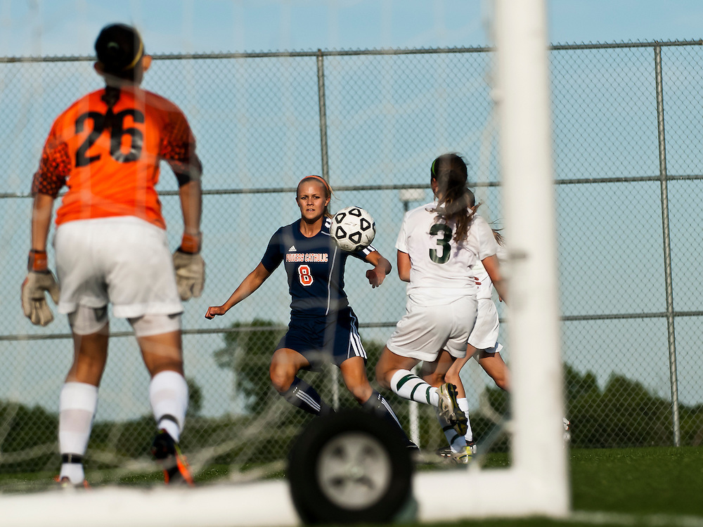 Maddi Reynolds of Flint Powers Catholic takes a shot on goal during a state semifinal game against Pontiac Notre Dame Prep at Lake Orion High School in Lake Orion, Mich. on Wednesday June 13, 2012. Powers defeated Notre Dame 2-0 to advance to the state finals.(Lathan Goumas | MLive.com)