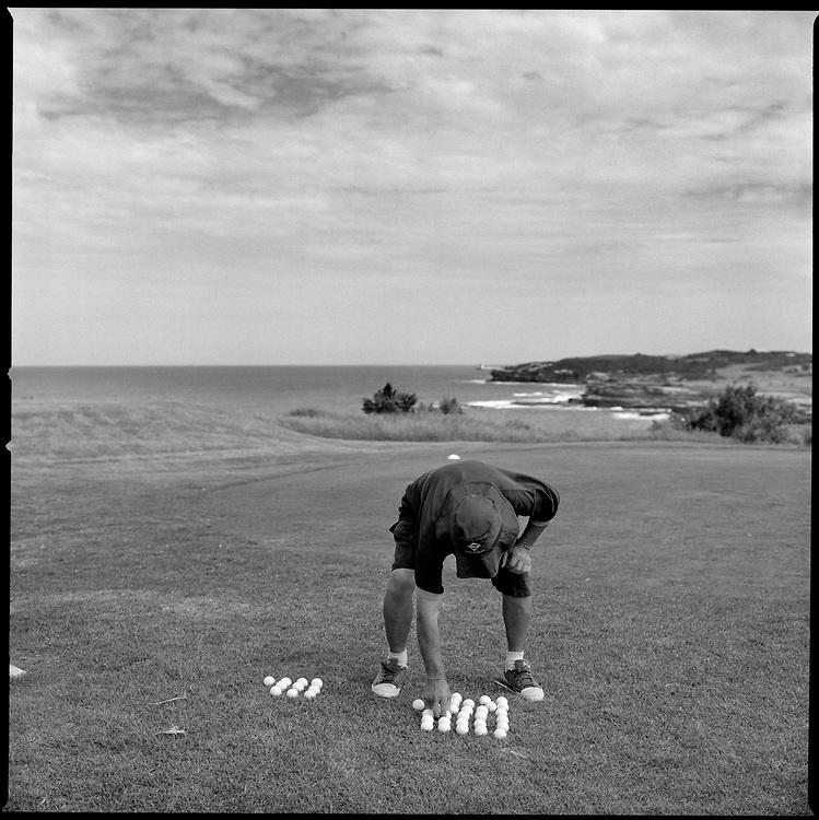 From a series titled: The Odd Ball.Pensioner, John King, spends his days collecting golf balls from the bushes and cliff faces surrounding the Coast Golf Course in Sydney, Australia before cleaning and reselling them to passing golfers to supplement his pension. .