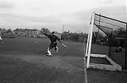 11/04/1964<br /> 04/11/1964<br /> 11 April 1964<br /> Irish Senior Hockey Cup Final, Three Rock Rovers v Church of Ireland (Cork) at Londonbridge Road, Dublin.  Church of Ireland Keeper Noel Johnston stretches to make a block.