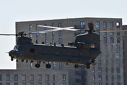 © Licensed to London News Pictures. 20/04/2020.  London UK: An RAF Chinook helicopter lands at the Nightingale hospital in East London. Photo credit: Steve Poston/LNP