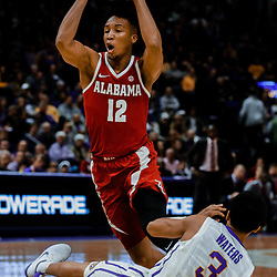 Jan 13, 2018; Baton Rouge, LA, USA; Alabama Crimson Tide guard Dazon Ingram (12) trips over LSU Tigers guard Tremont Waters (3) during the first half at the Pete Maravich Assembly Center. Mandatory Credit: Derick E. Hingle-USA TODAY Sports