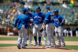 OAKLAND, CA - JULY 23:  R.A. Dickey #43 of the Toronto Blue Jays is relieved by manager John Gibbons #5 during the ninth inning against the Oakland Athletics at O.co Coliseum on July 23, 2015 in Oakland, California. The Toronto Blue Jays defeated the Oakland Athletics 5-2. (Photo by Jason O. Watson/Getty Images) *** Local Caption *** R.A. Dickey; John Gibbons