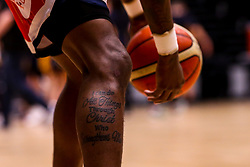 A tattoo on Fred Thomas of Bristol Flyers - Photo mandatory by-line: Robbie Stephenson/JMP - 01/03/2019 - BASKETBALL - Eagles Community Arena - Newcastle upon Tyne, England - Newcastle Eagles v Bristol Flyers - British Basketball League Championship