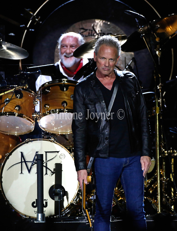 (L-R)  Mick Fleetwood, and Lindsey Buckingham of Fleetwood Mac perform live on stage at 02 Arena on September 24, 2013 in London, England.  (Photo by Simone Joyner)
