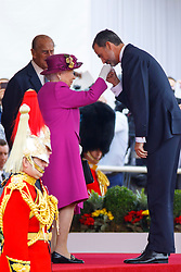© Licensed to London News Pictures. 12/07/2017. London, UK. Queen Elizabeth II welcomes King Felipe VI of Spain on Horse Guards Parade in London on the first day of State visit of the King and Queen of Spain. Photo credit: Tolga Akmen/LNP