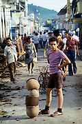 A young refugee of the Civil War in Nicaragua sells pots salvaged from a shop attacked and burned by government National Guard troops during the 1978 civil war.