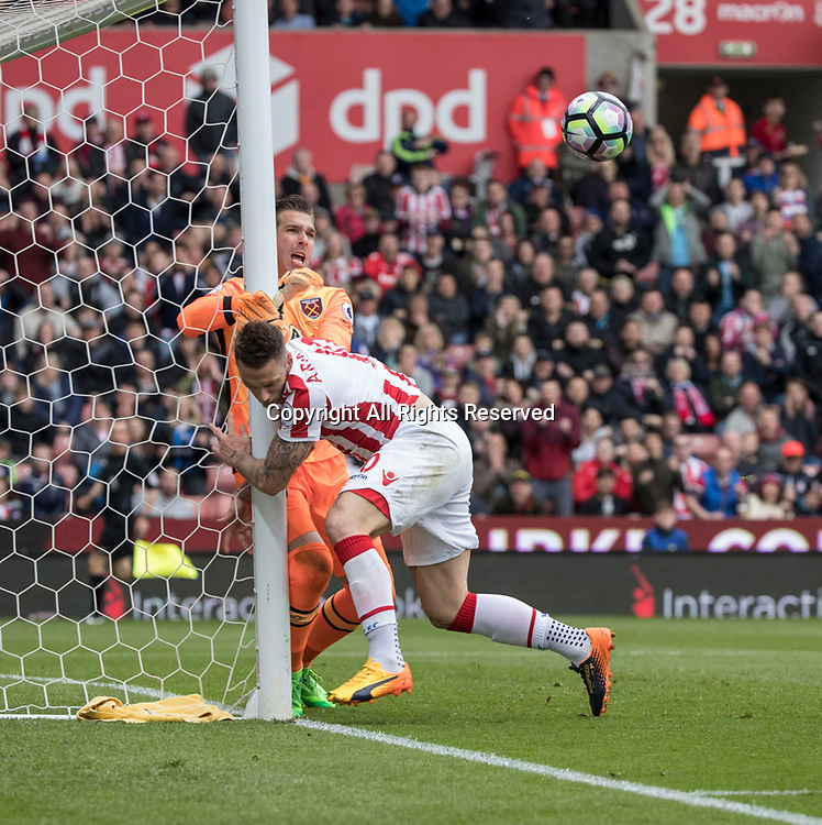 April 29th 2017, bet365 Stadium, Stoke, Staffordshire, England, EPL Premier League football, Stoke City versus West Ham United; Marko Arnautovic of Stoke City clashes with Adrian of West Ham United during a Stoke attack in the second half