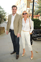 """GONHALO MOLLA and CAZ MacCLANCY at a party to celebrate the publication of the Paper back edition of """"A Lion Called Christian"""" held at Julie's Restaurant & Bar, 135 Portland Road, London W11 on 28th June 2010."""