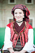 Brodsko kolo, Slavonski Brod, Croatia (9 June 2013). Young woman from Vranovci-Bukovlje in traditional folk costume. The Brodsko kolo, now in its 49th year, is the oldest folk dancing festival in Croatia.
