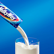 Milk pouring from a MilkyWay bar into a glass on a blue background Ray Massey is an established, award winning, UK professional  photographer, shooting creative advertising and editorial images from his stunning studio in a converted church in Camden Town, London NW1. Ray Massey specialises in drinks and liquids, still life and hands, product, gymnastics, special effects (sfx) and location photography. He is particularly known for dynamic high speed action shots of pours, bubbles, splashes and explosions in beers, champagnes, sodas, cocktails and beverages of all descriptions, as well as perfumes, paint, ink, water – even ice! Ray Massey works throughout the world with advertising agencies, designers, design groups, PR companies and directly with clients. He regularly manages the entire creative process, including post-production composition, manipulation and retouching, working with his team of retouchers to produce final images ready for publication.