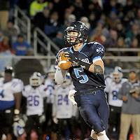 Hoggard's Austin Schoenleber looks to pass against Scotland High School Friday November 28, 2014 at Hoggard High School in Wilmington, N.C. (Jason A. Frizzelle)