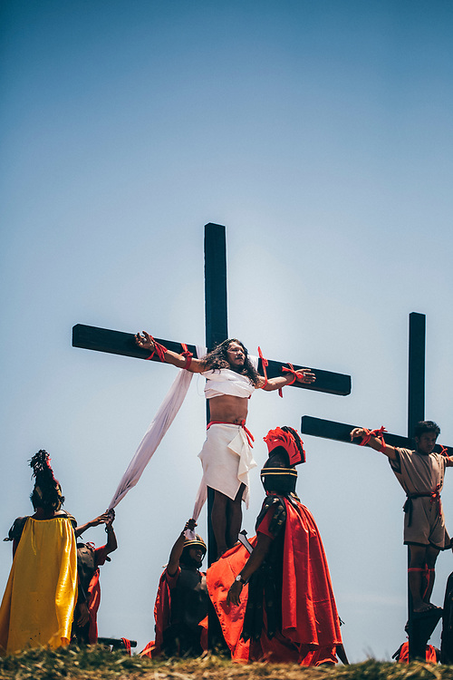 Ruben Enaje, playing the role of Jesus Christ, is crucified on a cross, with nails in his hands and feet, in Cutud, the Philippines, during the Holy Week festival.