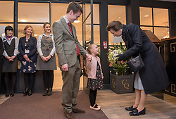 © Licensed to London News Pictures. 13/04/2018. Keynsham, Bath & North East Somerset, UK. PRINCESS ANNE accepts a posey of flowers from Evie Nicholls age 5. Visit of Her Royal Highness, The Princess Royal, PRINCESS ANNE, to switch on a giant sun art installation marking the Grand Opening of the development of the Chocolate Quarter in Keynsham on the site of the former Frys and Cadburys Chocolate factory which closed in 2011. The art installation is a giant artificial sun that will glow between the iconic red-brick buildings, radiating warmth, light and sound for a sensory exploration that the public are invited to discover and walk beneath. The installation is seven metres high and six metres wide and symbolises a new dawn for the historic building which is now home to a vast intergenerational living complex of retirement homes, pizzeria, restaurant, spa and cinema. The Chocolate Quarter is home to 136 retirement apartments and Charterhouse, a 93-bed care home. Photo credit: Simon Chapman/LNP