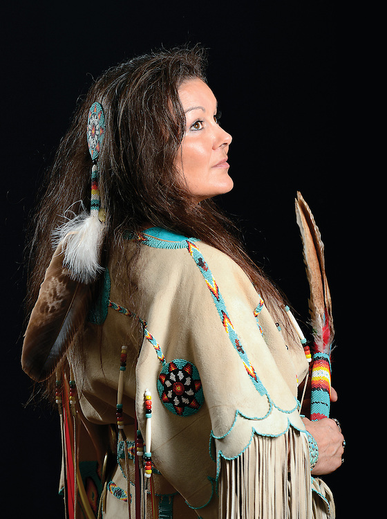 Native American Quapaw in handmade buckskin dress.