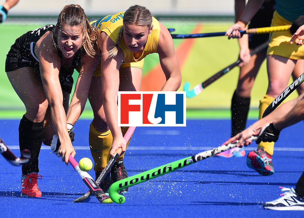 New Zealand's Rose Keddell (L) vies with Australia's Mariah Williams during the women's quarterfinal field hockey New Zealand vs Australia match of the Rio 2016 Olympics Games at the Olympic Hockey Centre in Rio de Janeiro on August 15, 2016. / AFP / Carl DE SOUZA        (Photo credit should read CARL DE SOUZA/AFP/Getty Images)