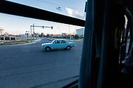 Monochromatic traffic, Tashkent, Uzbekistan.<br /> Picture date: Thursday March 15, 2018.<br /> Photograph by Christopher Ison &copy;<br /> 07544044177<br /> chris@christopherison.com<br /> www.christopherison.com