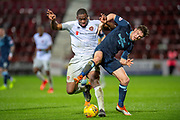 Blair Spittal (#7) of Partick Thistle FC tackles Uche Ikpeazu (#19) of Heart of Midlothian during the William Hill Scottish Cup quarter final replay match between Heart of Midlothian and Partick Thistle at Tynecastle Stadium, Gorgie, Edinburgh Scotland on 12 March 2019.
