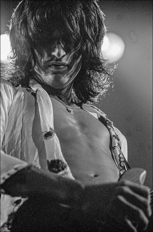 Joe Perry performs with Aerosmith at the Honolulu International Center Arena in 1975.  The Honolulu International Center (HIC) has now been re-named the Neil S. Blaisdell Arena..©PF Bentley/PFPIX.com
