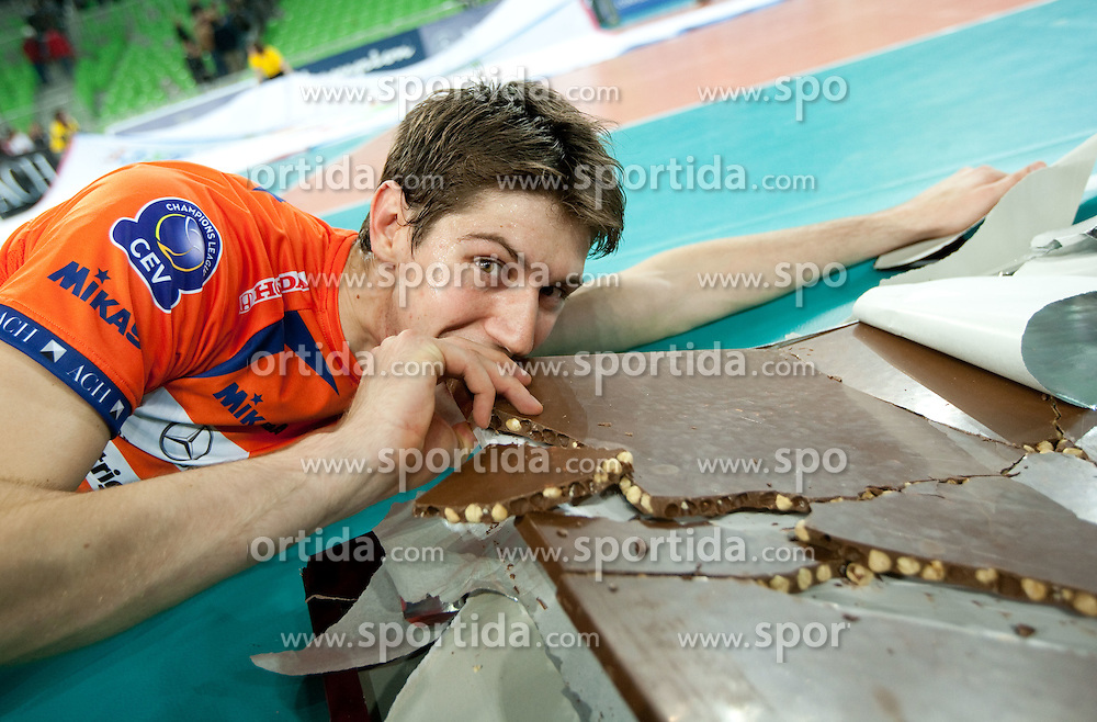 Matevz Kamnik of ACH celebrates his birthday with chocolate after the volleyball match between ACH Volley (SLO) and Budvanska Rivijera (MNE) in 2nd Round of 2011 CEV Champions League, on November 24, 2010 in Arena Stozice, Ljubljana, Slovenia. ACH defeated  Budvanska Rivijera 3-0. (Photo By Vid Ponikvar / Sportida.com)