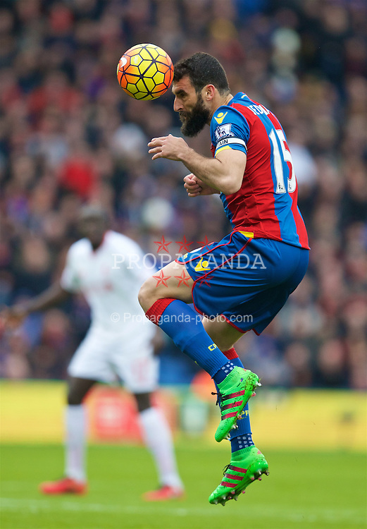 LONDON, ENGLAND - Sunday, March 6, 2016: Crystal Palace's captain Mile Jedinak in action against Liverpool during the Premier League match at Selhurst Park. (Pic by David Rawcliffe/Propaganda)