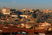 PORTUGAL, NORTH, DOURO RIVER, PORTO skyline of Porto appears across Douro River above the roofs of the Port Wine lodges in Vila Nova de Gaia