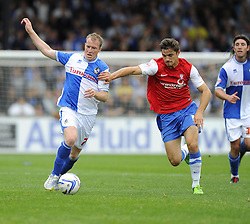 Bristol Rovers' David Clarkson battles for the ball with York City's Tom Platt  - Photo mandatory by-line: Joe Meredith/JMP - Tel: Mobile: 07966 386802 24/08/2013 - SPORT - FOOTBALL - Memorial Stadium - Bristol -  Bristol Rovers V York City - Sky Bet League Two