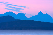 View of the Coast Mountains and the Sunshine Coast at dusk across the Strait of Georgia <br />Parksville<br />British Columbia<br />Canada