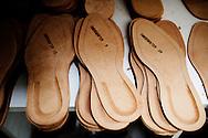 Corridonia, Marche - Suole grezze all'interno del calzaturificio Santoni. Tutti gli operai sono altamente specializzati. Dalla scelta del pellame e del cuoio, al taglio della pelle, dalla velatura alla lucidatura. Ogni singola calzatura e fatta a mano. Le scarpe Santoni rappresentano il vero made in Italy.<br /> Ph. Roberto Salomone