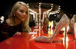 © licensed to London News Pictures. London, UK 30/04/2012. Angela Bell looking at the shoes designed by Christian Louboutin at Louboutin's new exhibition which celebrating 20 years of the famous red soled footwear brand at Design Museum in London. Photo credit: Tolga Akmen/LNP