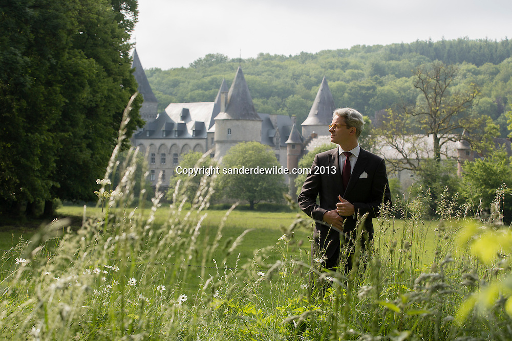 Interior architectThierry THENAERS poses in front of  the Chateau d'Anthée, part of which has been renovated and decorated by him in Anthée, Belgium on the 10th of June 2013, Anthée, Belgium. Credit Sander de Wilde for The Wall Street Journal.  Castle