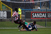Amari Morgan-Smith scores in the 40th minute during the Vanarama National League match between FC Halifax Town and Cheltenham Town at the Shay, Halifax, United Kingdom on 3 October 2015. Photo by Antony Thompson.