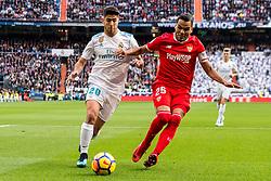 (L-R) Marco Asensio of Real Madrid, Gabriel Ivan Marcado of Sevilla FC during the La Liga Santander match between Real Madrid CF and Sevilla FC on December 09, 2017 at the Santiago Bernabeu stadium in Madrid, Spain.