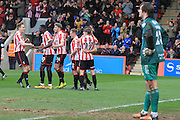 Dan Holman scores and celebrates his penalty goal during the Vanarama National League match between Cheltenham Town and FC Halifax Town at Whaddon Road, Cheltenham, England on 16 April 2016. Photo by Antony Thompson.
