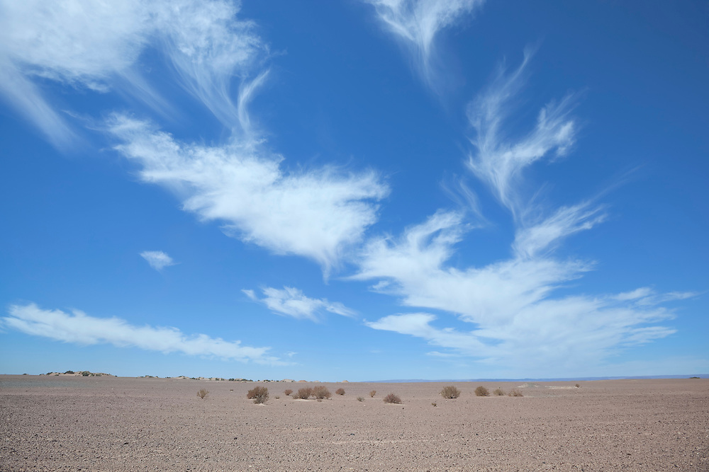Desert landscape with cloudy blue sky, Sahara desert, Morocco.