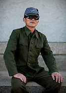 A North Korean worker on the Chilbo sea, wearing a Nike hat.<br /> -Did you notice that man? He&rsquo;s wearing an<br /> American cap!<br /> -It's not an American cap Mr Eric; it's a Chinese one.