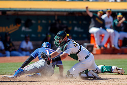 OAKLAND, CA - JULY 28:  Shin-Soo Choo #17 of the Texas Rangers is tagged out at home plate by Chris Herrmann #5 of the Oakland Athletics during the eighth inning at the RingCentral Coliseum on July 28, 2019 in Oakland, California. The Oakland Athletics defeated the Texas Rangers 6-5.(Photo by Jason O. Watson/Getty Images) *** Local Caption *** Shin-Soo Choo; Chris Herrmann