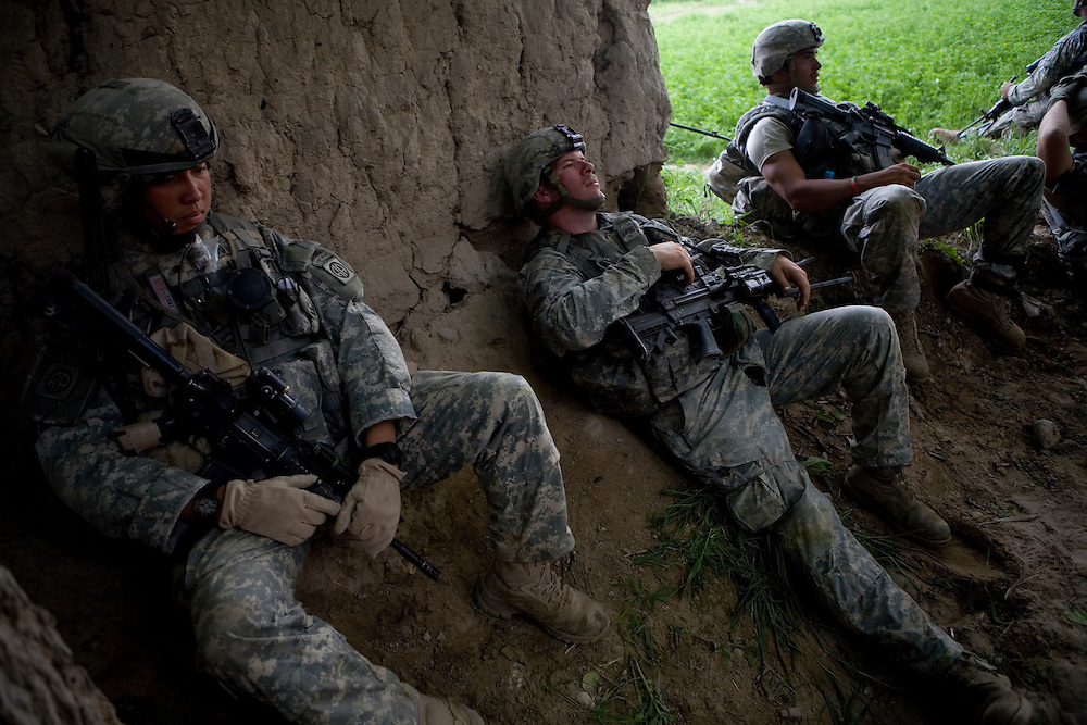 From left, Specialist Ying Kit Tsui, Private Dan Burris, and Private Luis Moreira recoup after an intense five hour firefight in Sangin, Helmand province, Afghanistan on Thursday, April 5, 2007.