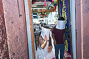 Young children wearing simple paper masks play in the doorway of a shop during the final day of the Day of the Dead festival November 2, 2016 in San Miguel de Allende, Guanajuato, Mexico. The week-long celebration is a time when Mexicans welcome the dead back to earth for a visit and celebrate life.