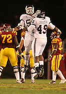 25 OCTOBER 2008: Texas A&M defensive lineman Danny Baker (55) and Texas A&M defensive lineman Cyril Obiozor (49) celebrate a sack .in the first half of an NCAA college football game between Iowa State and Texas A&M, at Jack Trice Stadium in Ames, Iowa on Saturday Oct. 25, 2008. Texas A&M beat Iowa State 49-35.