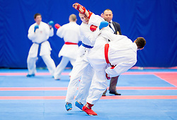 Rem Maric (blue) of Slovenia fighting against Team of Ukraine (red) during Kumite Team male at Day Two of Karate 1 World Cup - Thermana Slovenia Lasko 2014 tournament, on March 16, 2014 in Arena Tri Lilije, Lasko, Slovenia.Photo by Vid Ponikvar / Sportida