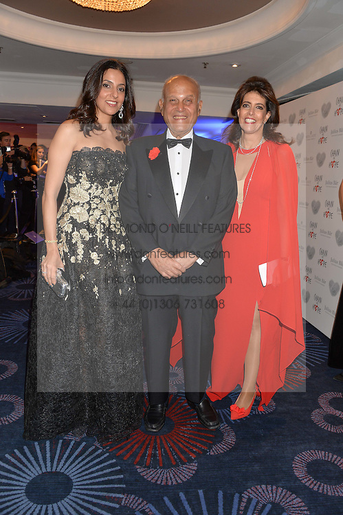 Left to right, Mrs Sherine Sawiris, Sir Magdi Yacoub and Mrs Dina Roushdi at the Chain of Hope Gala Ball held at The Grosvenor House Hotel, Park Lane, London on 18th November 2016.