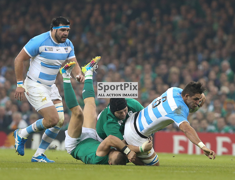 Pablo Matera of Argentina is tackled during the Rugby World Cup Quarter Final, Ireland v Argentina, Sunday 18 October 2015, Millenium Stadium, Cardiff (Photo by Mike Poole - Photopoole)