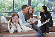Parents with bored daughter (7-9) and estate agent discussing new property
