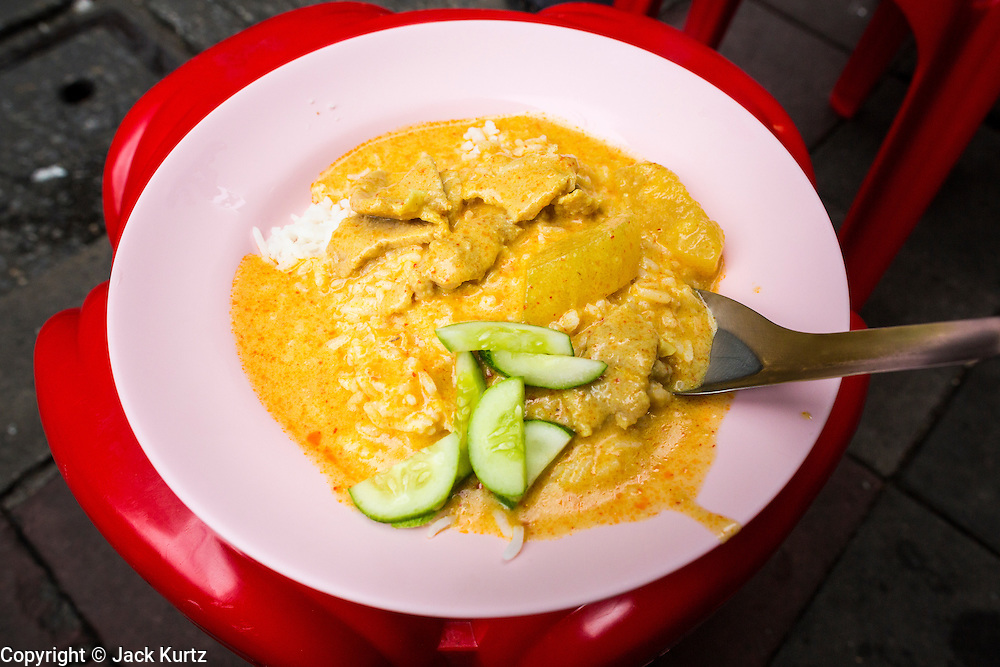 18 SEPTEMBER 2013 - BANGKOK, THAILAND:  A plate of pork curry at a curry stand in the Chinatown section of Bangkok. Thailand in general, and Bangkok in particular, has a vibrant tradition of street food and eating on the run. In recent years, Bangkok's street food has become something of an international landmark and is being written about in glossy travel magazines and in the pages of the New York Times.     PHOTO BY JACK KURTZ